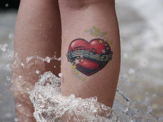 11-The-music-is-Duran-leg-tattoo