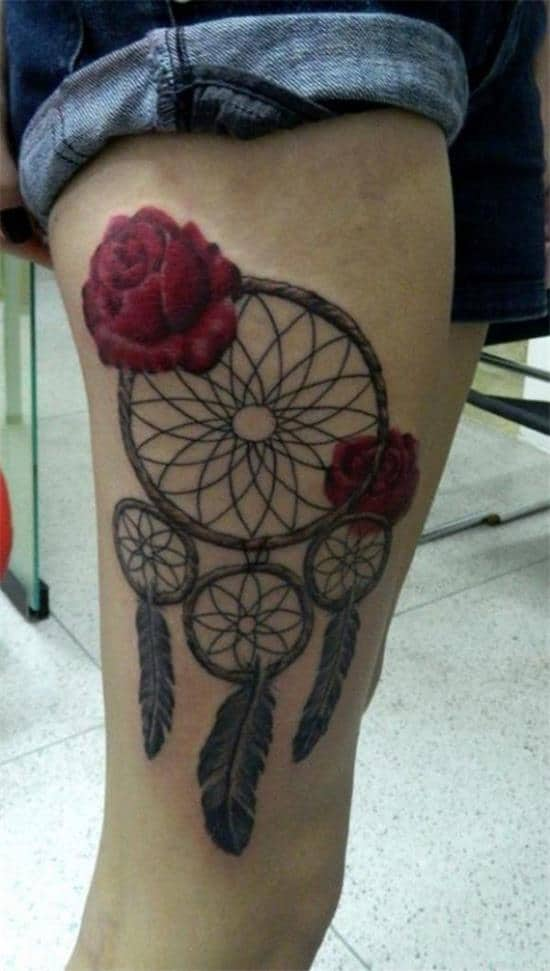 dreamcatcher and roses tattoo idea on thigh