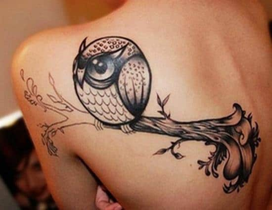 cute owl back tattoo