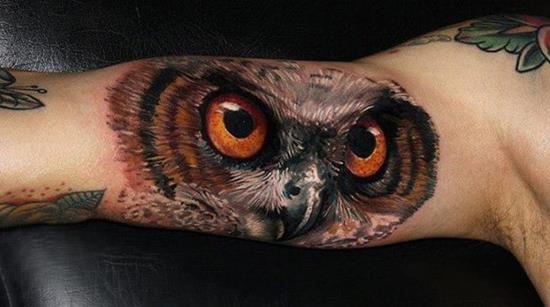 3d bicep owl face tattoo