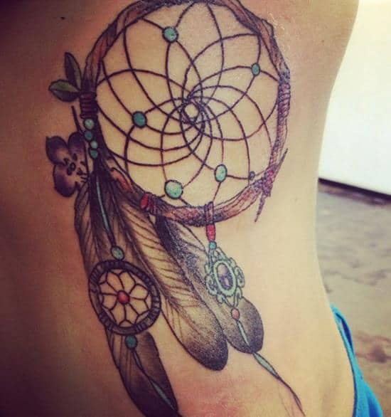 dreamcatcher tattoo on side idea