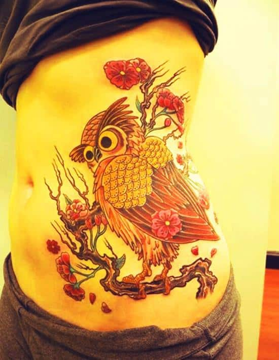 owl tattoo on waist