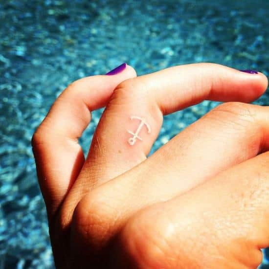 44-White-ink-anchor-finger-tattoo
