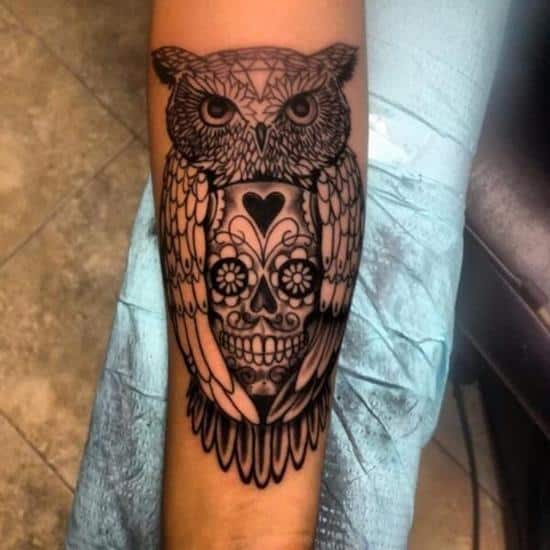 owl and skull on boy tattoo