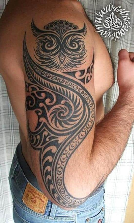 tribal owl arm tattoo