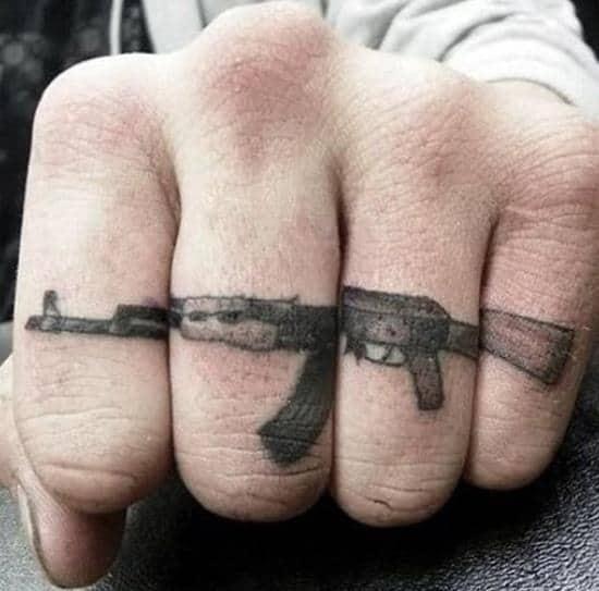 54-gun-finger-tattoo