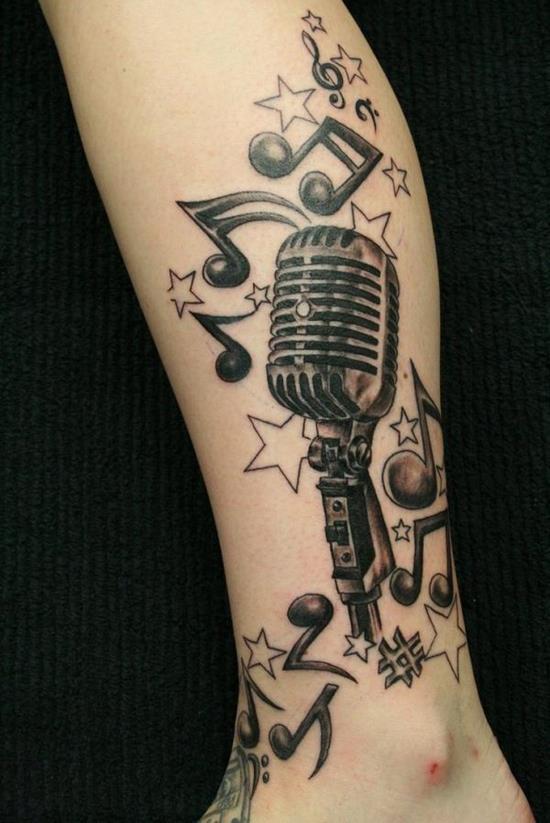9-tattoo-design-of-mic-notes-tattoo-on-leg