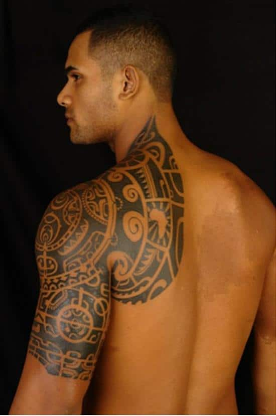 black-tribal-tattoo-on-shoulders-and-arm