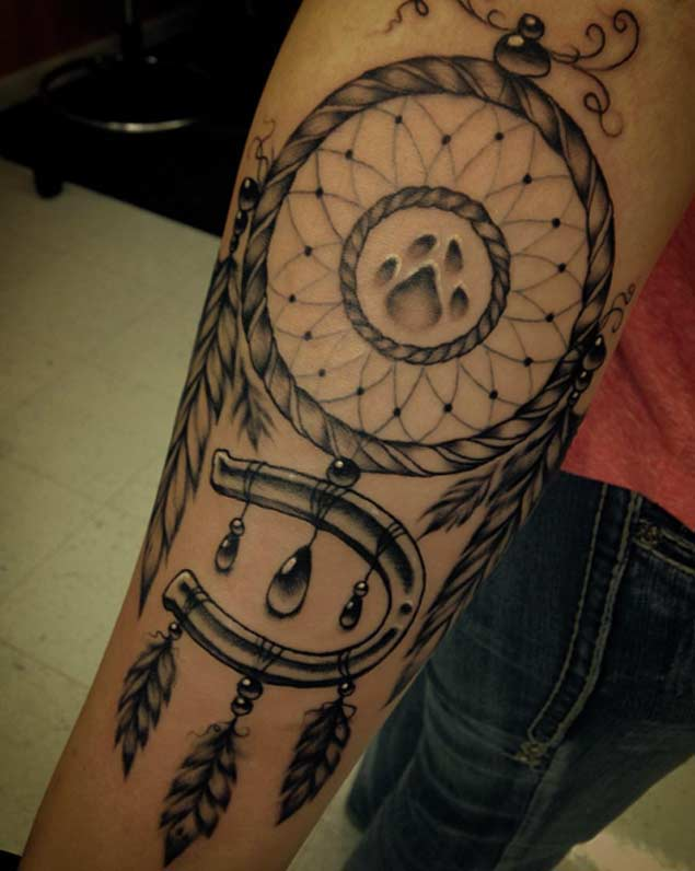 dreamcatcher arm tattoo