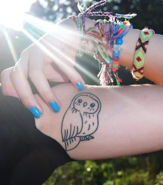 cartoon small owl tattoo