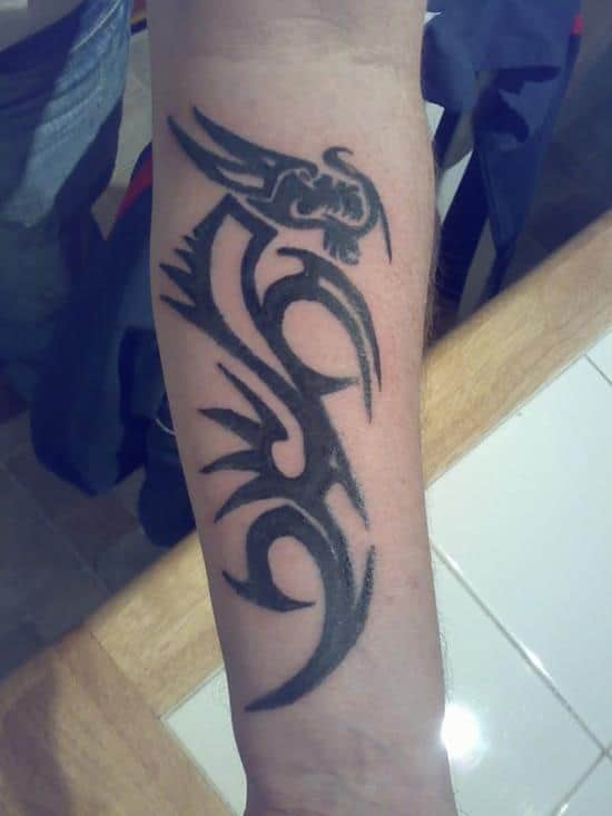 tribal-dragon-symbol-tattoo