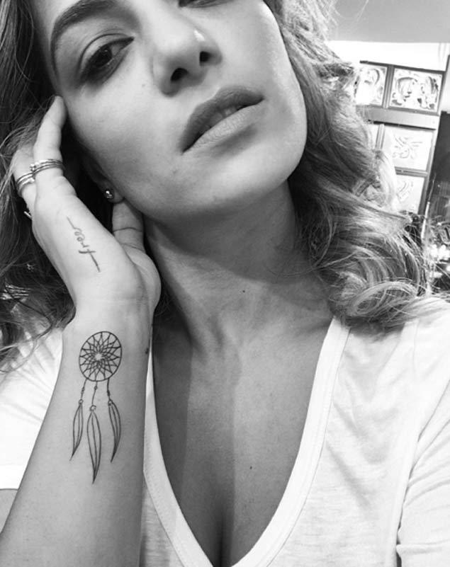 Tiny Dreamcatcher Tattoo on Wrist