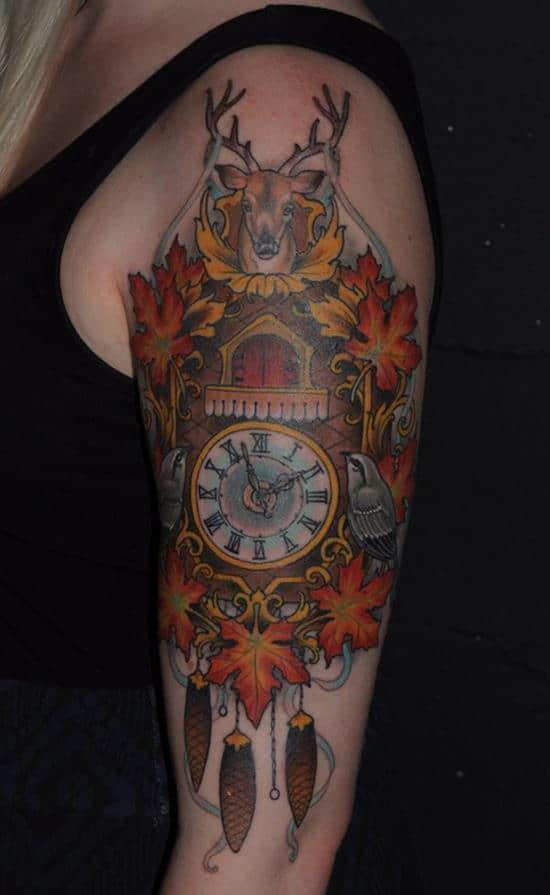 deer on top watch arm tattoo