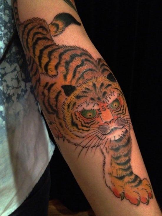 asian tiger tattoo on arm