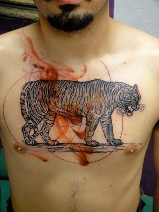 large tiger tattoo on man's chest