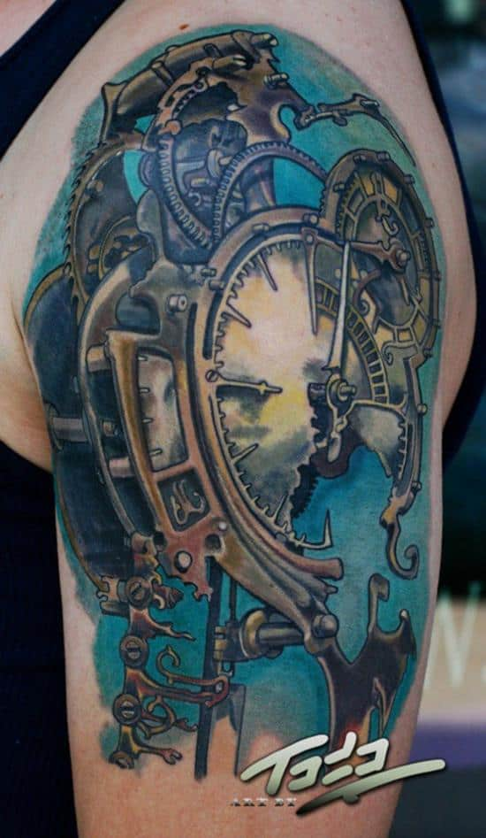 Freitas steampunk clock tattoo on arm