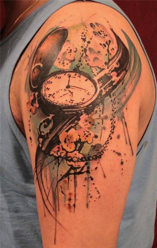 open face clock tattoo on shoulder