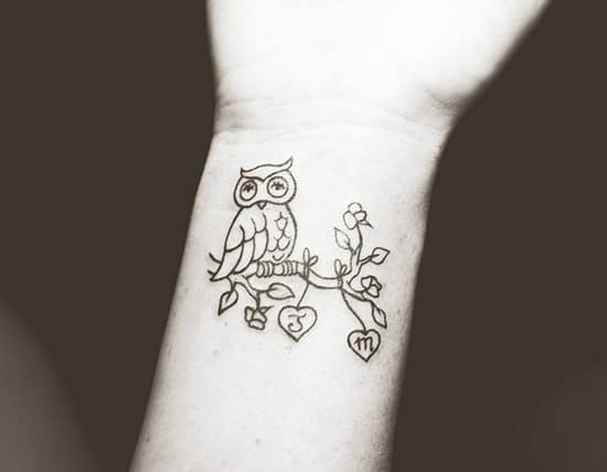 36-owl-tattoo-on-wrist