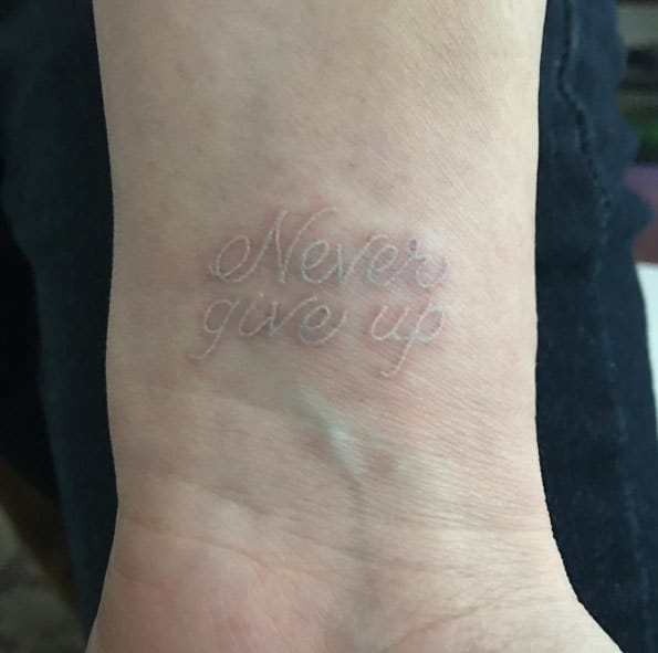 Never Give Up White Ink Tattoo by Caitlin Finney