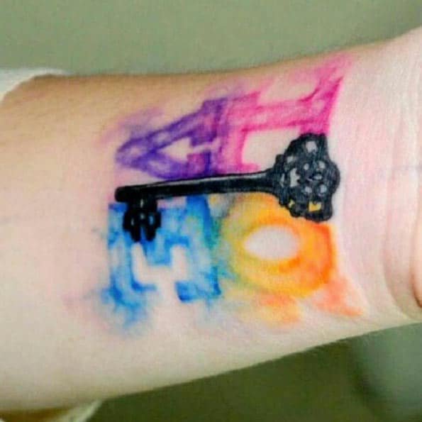 Watercolor LOVE Tattoo on Wrist by Koray Karagozler