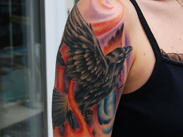 Black-Bird-Flying-Tattoo-on-Arm