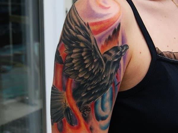 Black-Bird-Flying-Tattoo-on-Arm