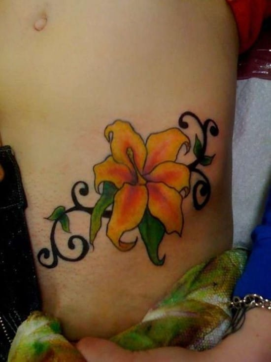 Bright-and-sexy-flower-hip-tattoo-design