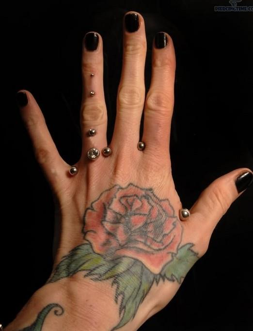 Rose-tattoo-on-hand-Women-tattoos