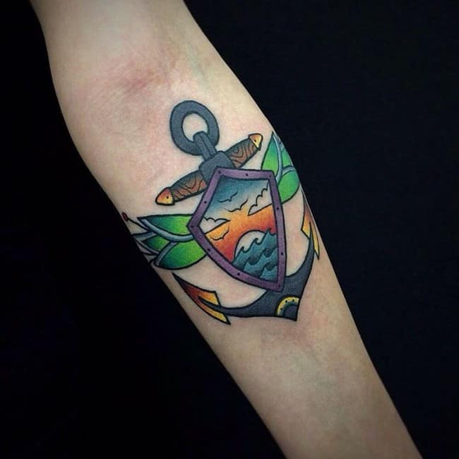 colorful anchor tattoo on forearm