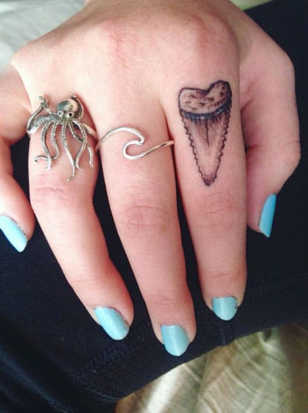 Shark Tooth Finger Tattoo by