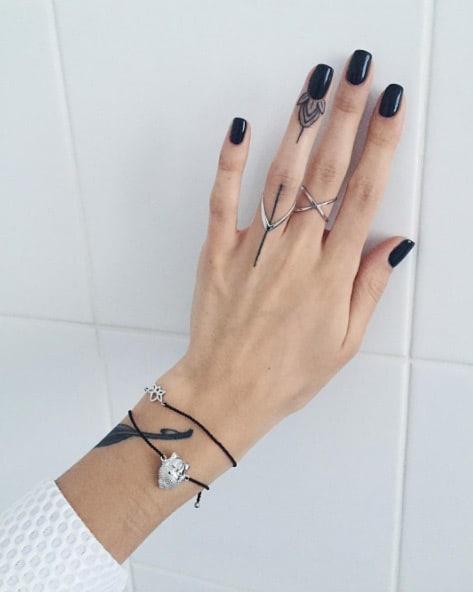 Elegant Finger Tattoo by Sasha Masiuk