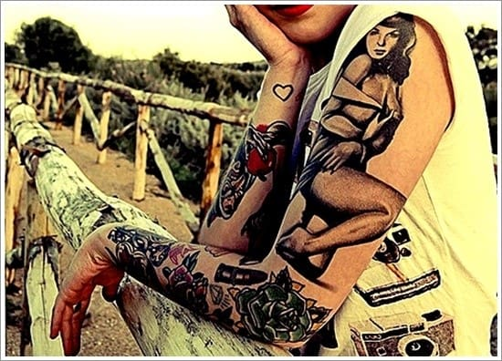 pin up girl tattoo on both arms