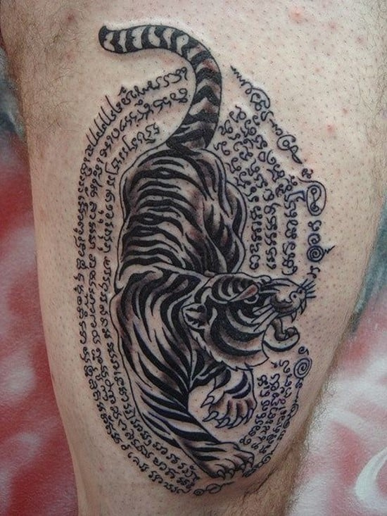 tiger with writing tattoo