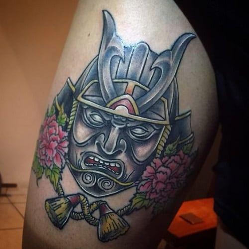 samurai tattoo on upper arm of man