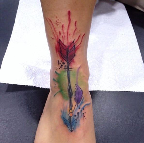 Watercolor Arrow Tattoo on Foot by Daniel Baker