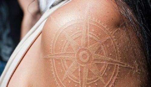 White Ink Compass Tattoo