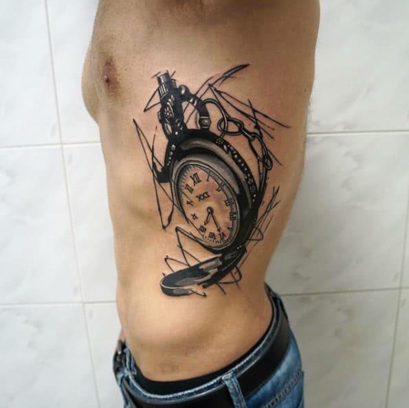 Pocket Watch Tattoo on Ribcage by Dynoz
