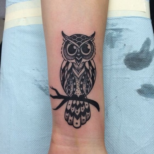 Black Owl Tattoo on Lower Arm