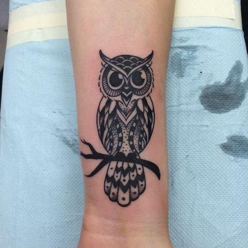 Black Owl Tattoo on Lower Arm