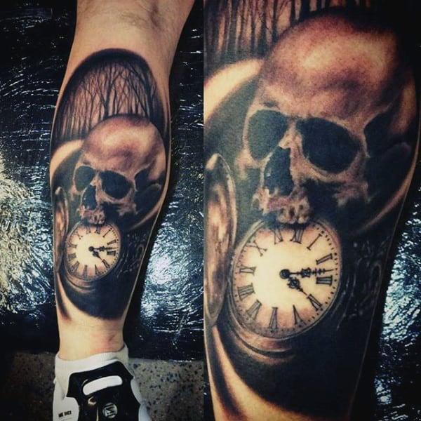 Evil Skull Biting Into Pocket Watch Tattoos On Calves For Men