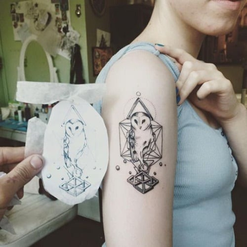 Geometric Owl Tattoos on Woman's Arm