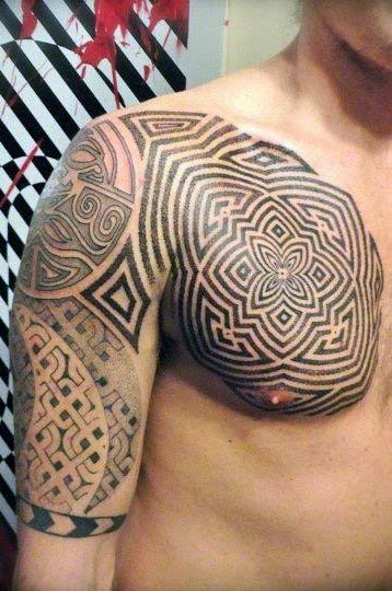 tribal chest and upper arm tattoo