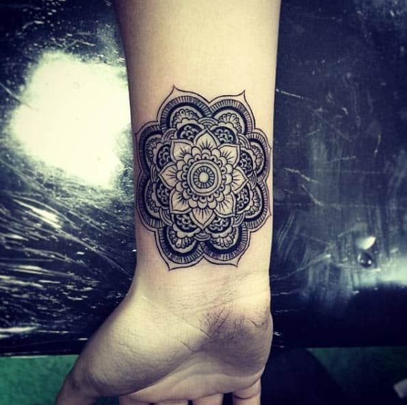 Beautiful mandala flower on wrist by Isaiah Negrete