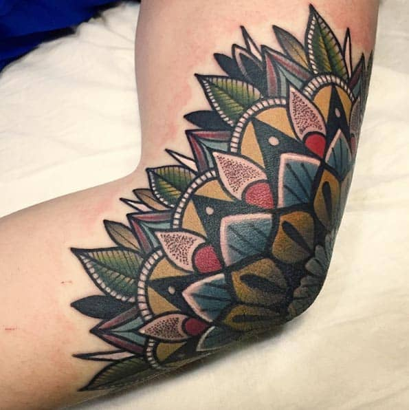 Colorful mandala flower on elbow by Mico
