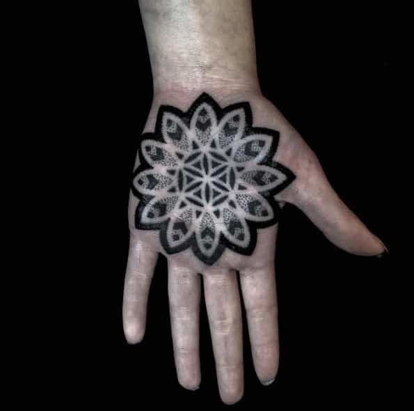 Mandala flower on palm by Helsinki