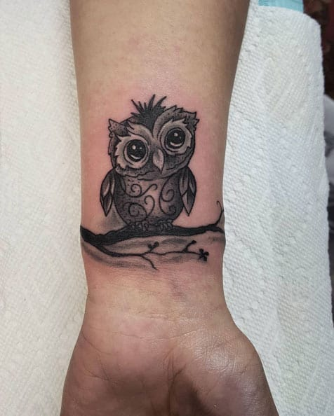 Owl Tattoo on Wrist by Andrew Hullings