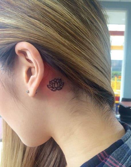 Minimalistic Lotus Flower Tattoo Behind Ear by Jen