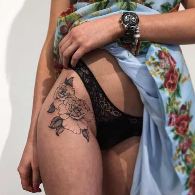 Sexy girl getting tattoo