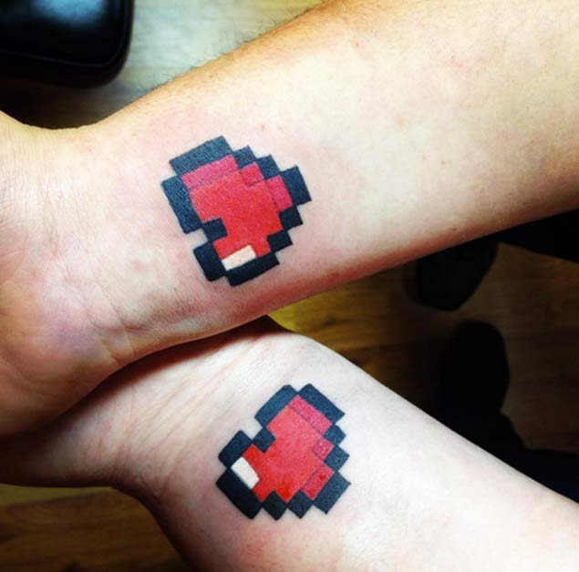 Pixelated Heart Couple Tattoos by Valerie Jane