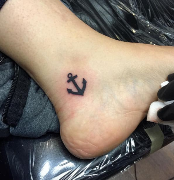 Tiny Anchor Tattoo on Ankle by Joe Christensen